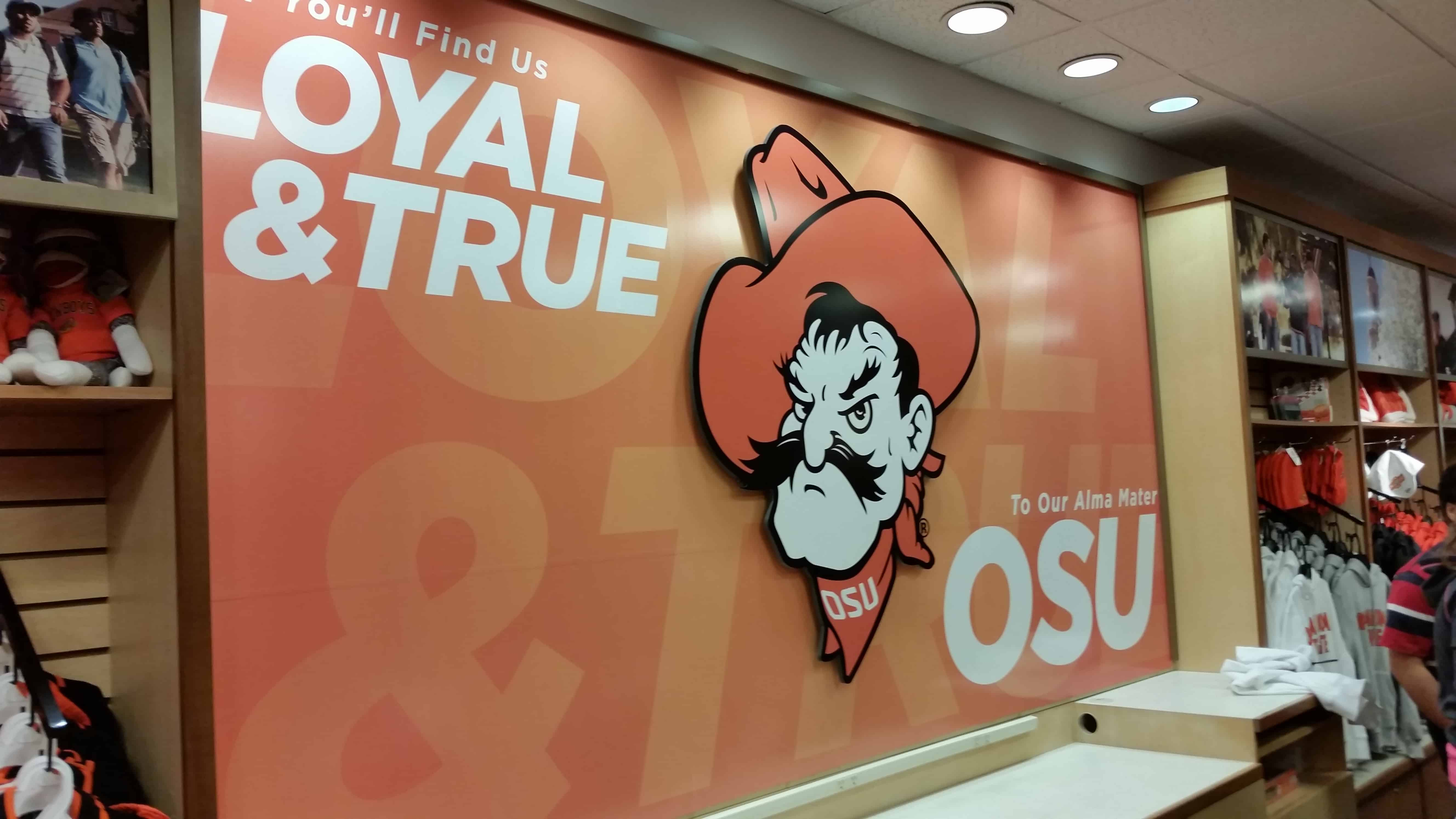 signs banners precision sign design page  oklahoma state university has opened a store for the holiday s at woodland hills mall like our page comment and share to be entered to win a 50 gift